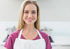Casual cheerful blonde looking at camera - stock photo