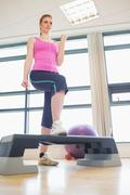 Woman at aerobics class in gym - stock photo