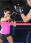 Determined female boxer practicing Stock Photos
