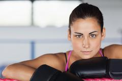 Beautiful young woman in black boxing gloves Stock Photos