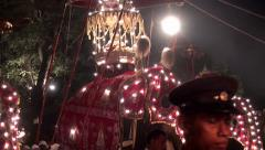 Casket with the relic of the Buddha Tooth on the back of an elephant.  Perahera Stock Footage