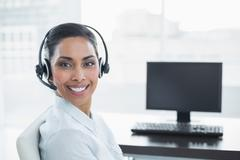 Content smiling agent wearing a headset - stock photo