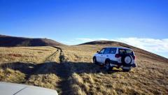 Off-road driving through a macedonian mountain plateau at high mountain Stock Footage