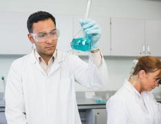 Researcher experimenting in the lab - stock photo