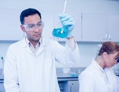 Male researcher experimenting in the lab - stock photo