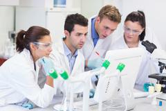 Researchers looking at computer screen in the lab Stock Photos