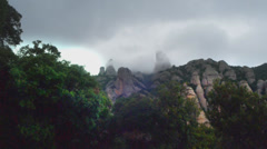 Montserrat mountains cloudy sky Stock Footage
