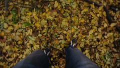 Feet of a man at yelow leaves Stock Footage
