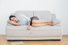 Stock Photo of Well dressed young woman sleeping on sofa