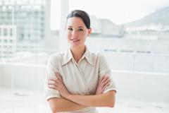 Stock Photo of Elegant businesswoman standing inoffice