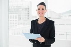 Portrait of an elegant businesswoman using tablet PC - stock photo