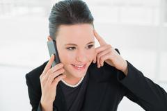 Smiling elegant businesswoman using cellphone Stock Photos