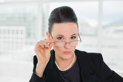 Elegant businesswoman wearing eyeglasses Stock Photos