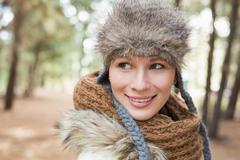 Woman in fur hat with woolen scarf in the woods Stock Photos
