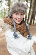 Woman in fur hat with woolen scarf and jacket in the woods Stock Photos