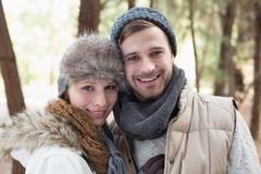 Stock Photo of Couple in winter clothing in the woods