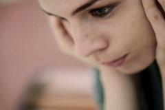 Close up of sad, depressed beautiful woman's face NTSC - stock footage