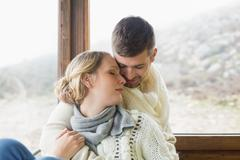 Stock Photo of Close up of a loving young couple in winter clothing