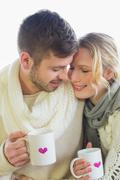 Stock Photo of Loving couple in winter clothing with coffee cups