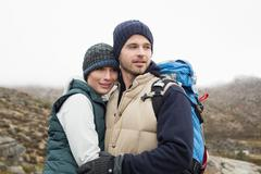 Stock Photo of Fit loving couple on a hike in the countryside