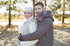 Stock Photo of Loving young couple in winter clothing in the woods