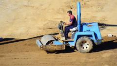 Roller compactor at road construction site. preparation of terrain Stock Footage