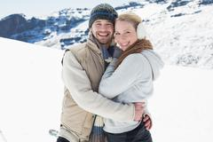 Loving couple in warm clothing on snowed landscape Stock Photos