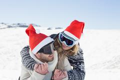 Close up of a cheerful couple in ski goggles on snow - stock photo