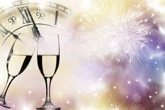 Glasses with champagne and holiday lights Stock Photos