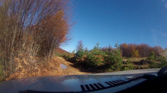 Off-road driving through a macedonian mountain forrest Stock Footage