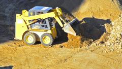 bulldozer pushing sand - stock video - stock footage