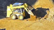 Stock Video Footage of bulldozer pushing sand - stock video