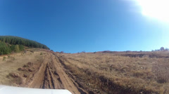 Point of view, day country side, dirt road driving. Stock Footage