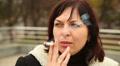 woman smokes a cigarette 1 HD Footage