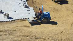 Roller compactor and bulldozer at road construction site Stock Footage