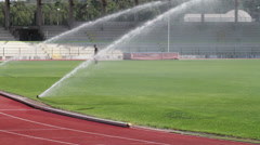 Running Track and Football Soccer Field Irrigation  1 - stock footage