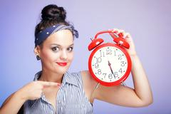 Stock Photo of woman with red clock. time management concept.
