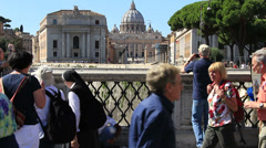Tourist takes a photograph of St Peters from afar Stock Footage
