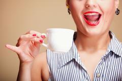 beautiful girl drinking tea or coffee. - stock photo