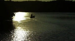Silhouette of a person canoeing in Tampa Bay - stock footage