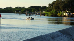 Boater going across a canal in Tampa Bay - stock footage