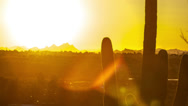 Stock Video Footage of HD 30p wide Arizona sunset over valley with tall Saguaro time lapse