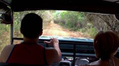 Tourists in an open jeep at the safari. Wilpattu NP, Sri Lanka. Stock Footage