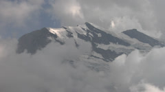 Snow capped mountains surrounded by clouds - Swiss Alps Stock Footage