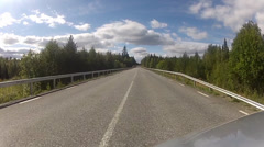 Pov of driving down a quiet rural highway during the day in summer Stock Footage