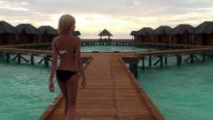 Girl at the water bungalows pontoon. Maldives Stock Footage