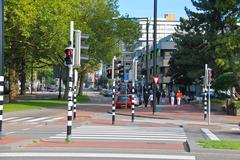 employed traffic lights at the   crossroads  in dordrecht, netherlands. - stock photo