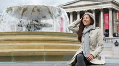 London woman on Trafalgar Square - stock footage