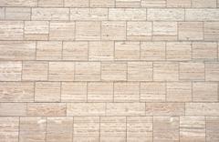 Brown granite wall - stock photo