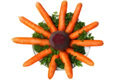 Carrots, beets, parsley on the plate on a white background. Stock Photos
